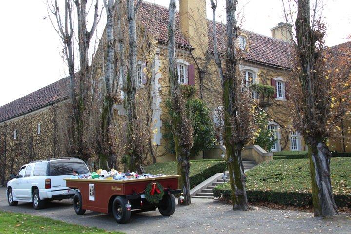 an SUV towing the Jordan Winery grape gondola full of toys at Jordan Winery