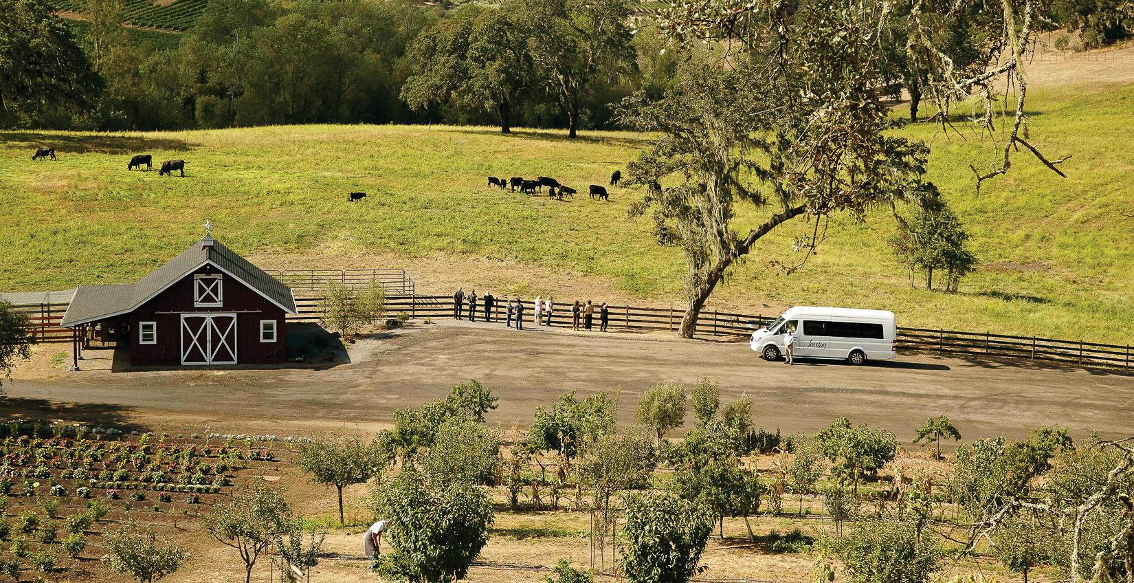 Landscape with barn, field, Jordan van and people